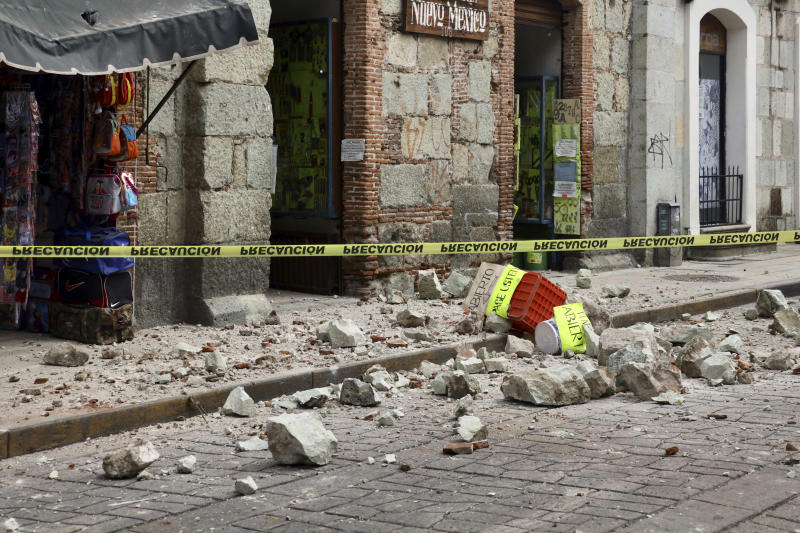Security tape alert people of a building damaged by an earthquake in Oaxaca, Mexico,Tuesday, June 23, 2020.  The earthquake was centered near the resort of Huatulco, in the southern state of Oaxaca. (AP Photo/Luis Alberto Cruz Hernandez)