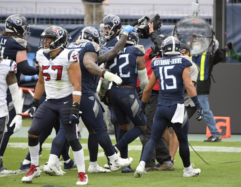 NFL roundup: Titans stay unbeaten with OT win