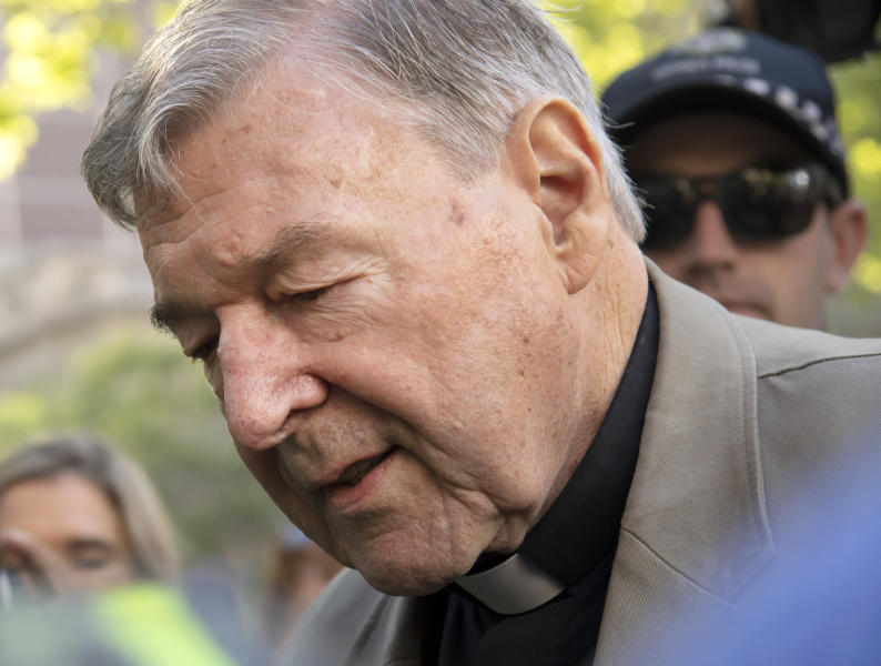 FILE - In this Feb. 27, 2019, file photo, Cardinal George Pell arrives at the County Court in Melbourne, Australia. Cardinal George Pell, the former Vatican finance minister who was convicted and then absolved of sexual abuse in his native Australia, is set to publish his prison diary musing on life in solitary confinement, the Psalms, the church, politics and sports. Catholic publisher Ignatius Press told The Associated Press on Saturday the first installment of the 1,000-page diary would likely be published in Spring 2021. (AP Photo/Andy Brownbill, File)