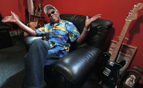 """In this Aug. 3, 2012 photo, blues legend Buddy Guy speaks about his new book, """"When I left Home"""" in the office of his blues club Buddy Guy's Legends in Chicago's South Loop.. (AP Photo/M. Spencer Green)"""