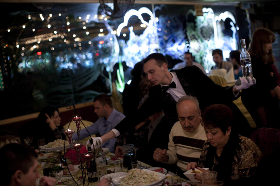 In this Feb. 3, 2012 photo, a waiter serves traditional Russian food at a seaside restaurant in Ashdod, a southern Israeli city heavily populated by immigrants from the former Soviet Union. (AP Photo/Oded Balilty)