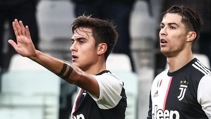 Pelatih Juventus, Maurizio Sarri, menegaskan Cristiano Ronaldo dan Paulo Dybala bisa main bersama. Menurut Sarri, duet keduanya cukup baik dan keduanya semakin kompak serta mampu tampil impresif. (AFP/Isabella Bonotto)