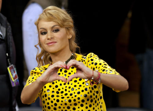"FILE - In this Aug. 21, 2012 file photo, Mexico's pop star Paulina Rubio flashes the hand heart symbol during a press conference in Mexico City. Rubio will be one of three coaches of the new US program ""La Voz Kids,"" announced the TV network Telemundo on Monday, March 18th 2013. The Mexican singer had previously participated as a coach for ""La Voz...Mexico"" and started her career when she was a girl, like the participants of ""La Voz Kids."" (AP Photo/Eduardo Verdugo, File)"