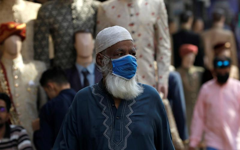 A man wears a protective face mask as the outbreak of the coronavirus disease continues, in Karachi, Pakistan.  - Akhtar Soomro /Reuters