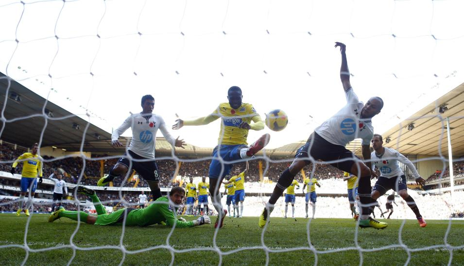 Newcastle United's Yanga-Mbiwa clears the ball off the line ahead of Tottenham Hotspur's Kaboul during their English Premier League soccer match in London