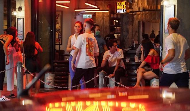 People enjoy the long weekend at a bar in Soho, Central. Photo: Felix Wong