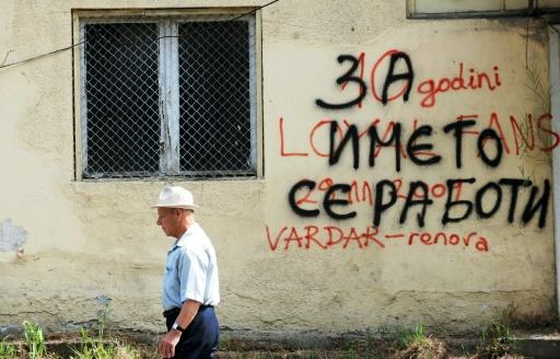 """It's about the name"" reads graffiti on a wall in central Skopje referring to a bitter dispute with Greece over Macedonia's name"