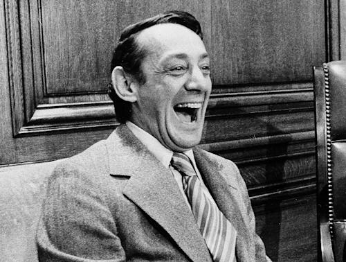 "FILE - This file photo from April 1977 shows San Francisco Supervisor Harvey Milk in the mayor's office during the signing of the city's gay rights bill in San Francisco. A new concert piece about slain gay rights leader Harvey Milk by Tony Award-nominee Andrew Lippa will have its world premiere in June in San Francisco. Producers said Monday, April 1, 2013, that ""I Am Harvey Milk"" _ part choral, part theater _ will be performed June 27-28 as part of the San Francisco Gay Men's Chorus 35th Anniversary Celebration concert. (AP Photo/file)"