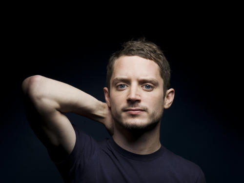 "FILE - In this June 24, 2011 file photo, Elijah Wood poses for a portrait in New York. Wood stars in the new FX series ""Wilfred."" (AP Photo/Victoria Will, File)"