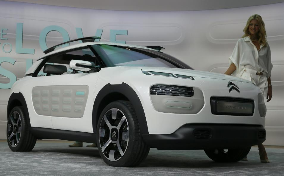 A model stands at Citroen Cactus concept car during a media preview day at the Frankfurt Motor Show