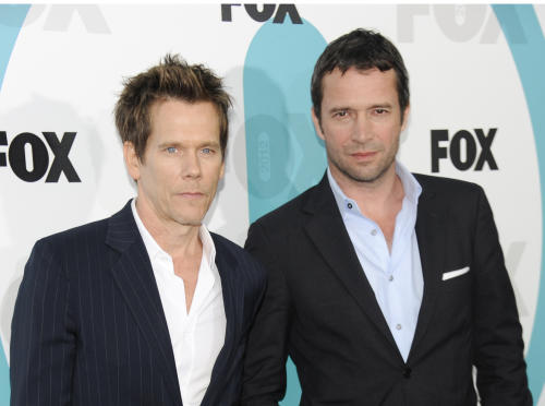 "FILE - In this May 14, 2012 file photo, ""The Following"" cast members Kevin Bacon, left, and James Purefoy attend the FOX network upfront presentation party at Wollman Rink, in New York. Things are getting a little steamy among the stars of Fox's new thriller, ""The Following."" The series, which debuts Jan. 21, 2013, features Kevin Bacon as an investigator pursuing a serial killer portrayed by James Purefoy. (AP Photo/Evan Agostini, File)"