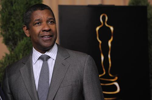 "Denzel Washington, nominated for best actor in a leading role for ""Flight,"" arrives at the 85th Academy Awards Nominees Luncheon at the Beverly Hilton Hotel on Monday, Feb. 4, 2013, in Beverly Hills, Calif. (Photo by Chris Pizzello/Invision/AP)"
