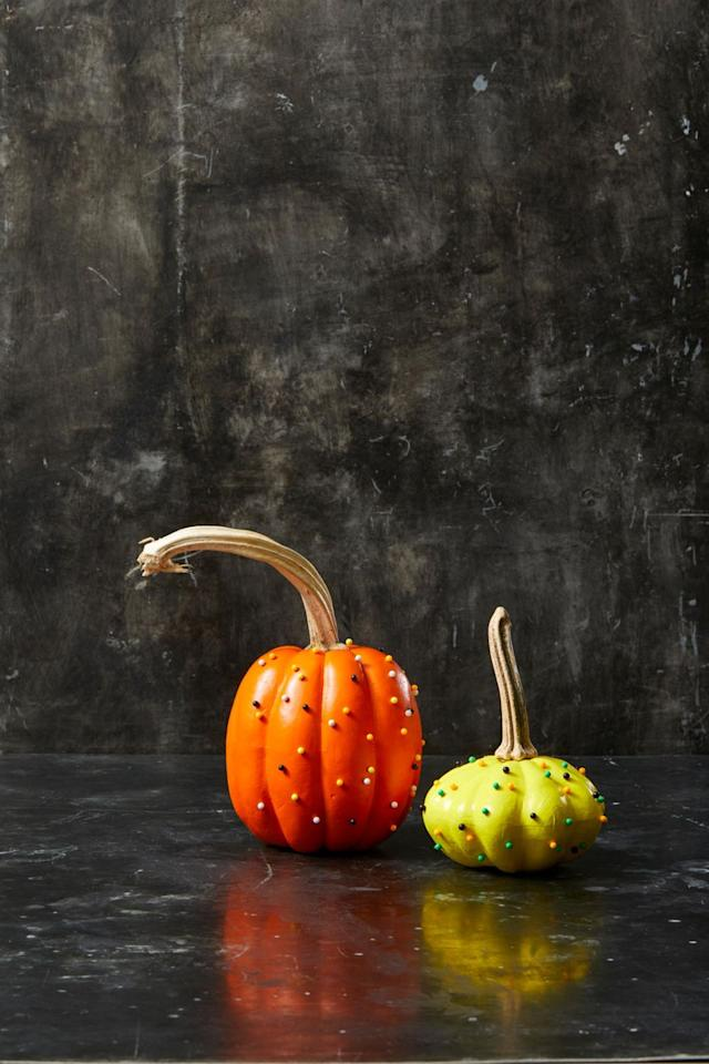 """<p>Put old office supplies to clever use with these map tack pumpkins. Simply paint a pumpkin a solid color and let it dry completely, then pin map tacks all over the pumpkin's surface.</p><p><a class=""""body-btn-link"""" href=""""https://www.amazon.com/gp/product/B01MXSJVM0/?tag=syn-yahoo-20&ascsubtag=%5Bartid%7C10055.g.1714%5Bsrc%7Cyahoo-us"""" target=""""_blank"""">SHOP MAP TACKS</a></p>"""