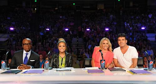 "This May 24, 2012 photo released by Fox shows judges, from left, L.A. Reid, Demi Lovato, Britney Spears and Simon Cowell from the singing competition series, ""The X Factor,"" in Austin, Texas. (AP Photo/Fox, Ray Mickshaw)"