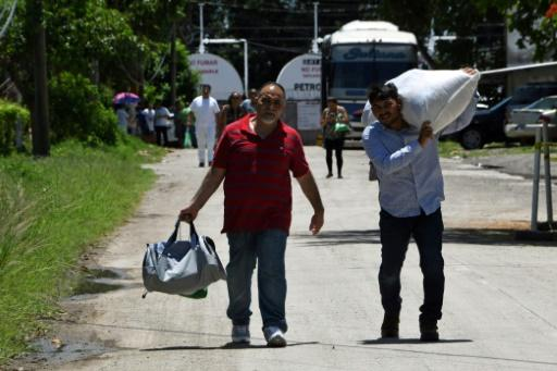 Hondurans deported from the US after trying to cross the border arrive back at the San Pedro Sula airport in Honduras on Friday