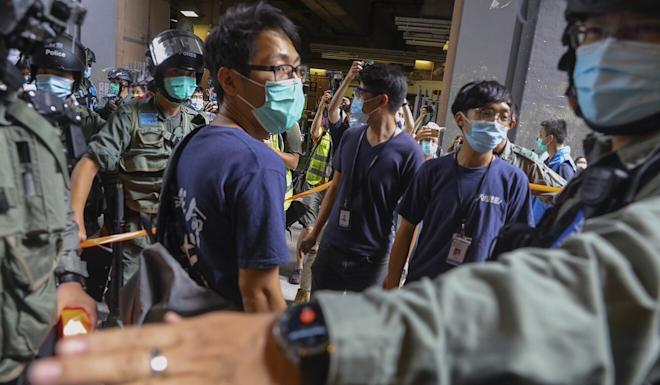 Riot police officers conduct a stop-and-search operation on protesters at Yuen Long on Sunday. Photo: Dickson Lee
