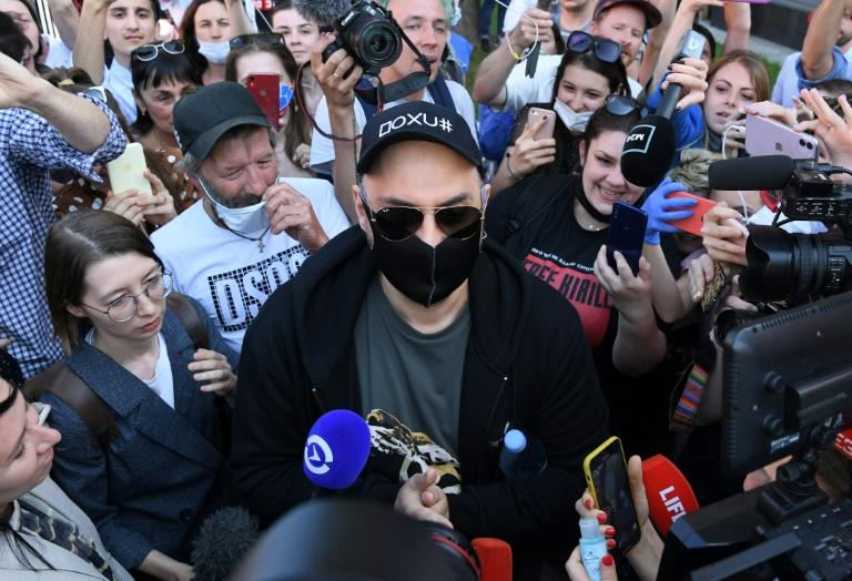 Wearing a black facemask, Russian director Kirill Serebrennikov greeted journalists and supporters outside the court after the ruling