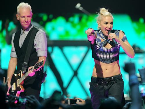 Gwen Stefani and Tom Dumont of No Doubt perform at the iHeart Radio Music Festival on Friday, Sept., 21, 2012 at the MGM Grand Arena in Las Vegas. (Photo by Eric Reed/Invision/AP)