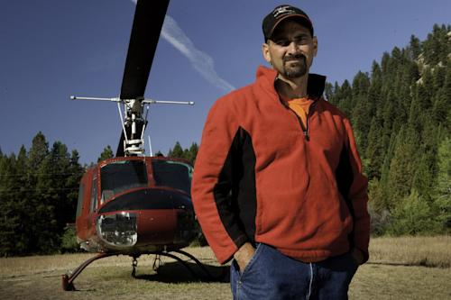 "This undated publicity photo released by History shows William Bart Colantuono in the History Channel TV series, ""Ax Men."" Colantuono, a pilot, was killed this week when his helicopter crashed while attempting to lift logs in an Oregon forest. He was a former cast member of the History Channel series, ""Ax Men."" (AP Photo/History)"