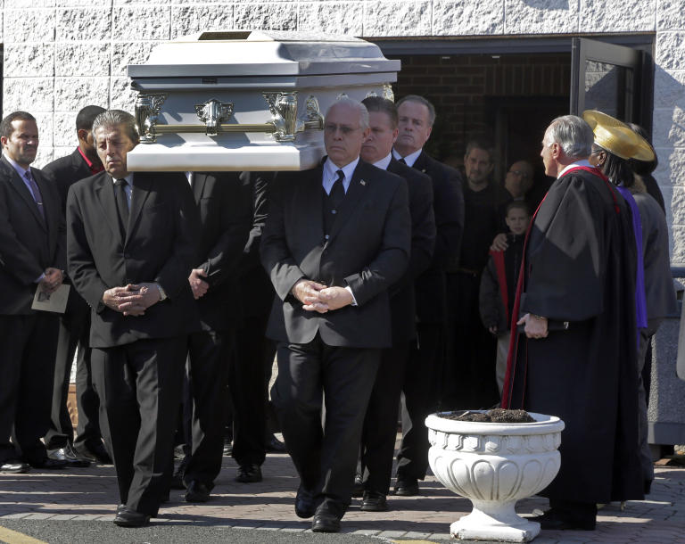 The casket of Sarai Sierra, is carried from the Christian Pentecostal Church,after her funeral in the Staten Island borough of New York,  Friday, Feb. 15, 2013.  The 33-year-old mother of two was killed while vacationing alone in Turkey. Her body was found in Istanbul, 12 days after she disappeared. Her nine-year-old son Silas Sierra, watches, at back right. (AP Photo/Richard Drew)