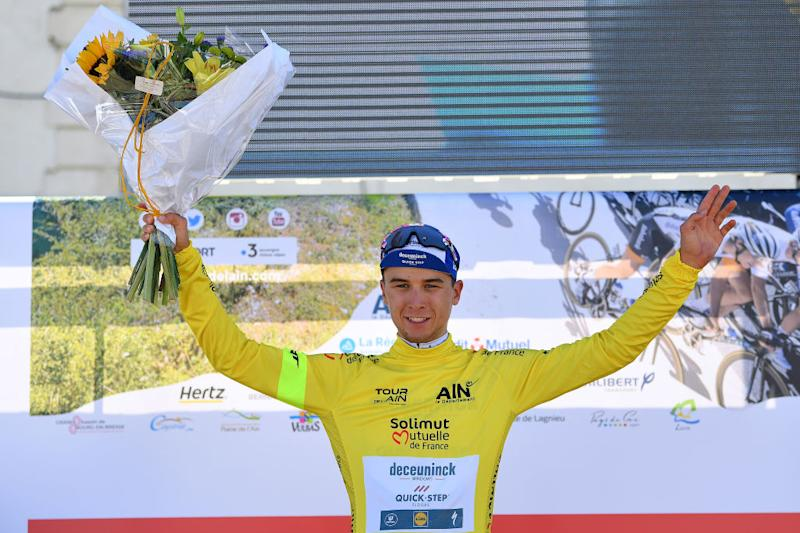 Stage 1 winner Andrea Bagioli of Deceuninck-QuickStep sports the general classification yellow.