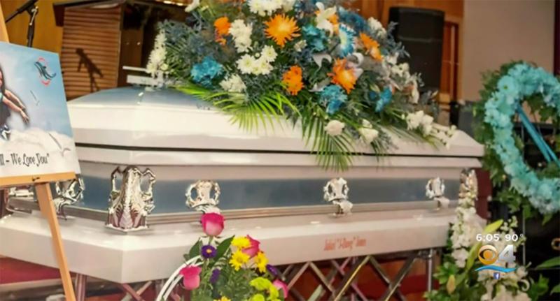 An image of a casket, with flowers taken at Jakiel Allyson Jones' funeral.