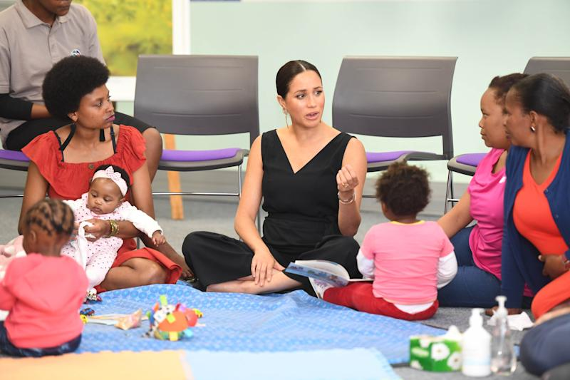 CAPE TOWN, SOUTH AFRICA - SEPTEMBER 25: Meghan, Duchess of Sussex visits mothers2mothers during her royal tour of South Africa with Prince Harry, Duke of Sussex on September 25, 2019 in Cape Town, South Africa. mothers2mothers (m2m) is an African not-for-profit organisation with the vision of a healthy, HIV-free Africa. The organisation trains and employs women living with HIV as frontline health workers across eight African nations. (Photo by Paul Edwards - Pool/Getty Images)