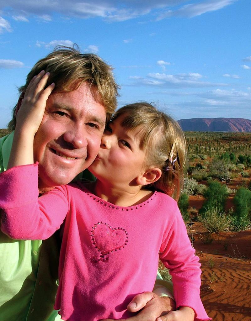 Young Bindi Irwin kisses Steve Irwin on the cheek