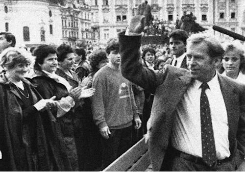 FILE - Czechoslovakian President Vaclav Havel waves to a cheering crowd in Prague, June 9, 1990. Havel, the dissident playwright who wove theater into politics to peacefully bring down communism in Czechoslovakia and become a hero of the epic struggle that ended the Cold War, died Sunday Dec. 18, 2011 in Prague. He was 75. (AP Photo/Kevin Harvey, File)