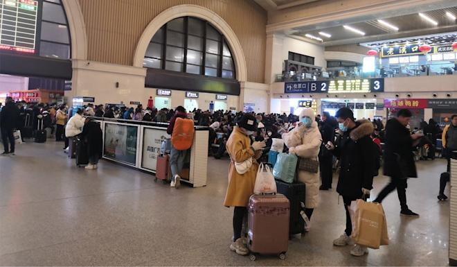 Passengers at the Wuhan train station waiting to leave the city on Thursday morning. Photo: Handout