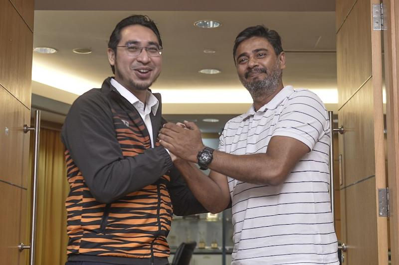 Deputy Youth and Sports Minister Wan Ahmad Fayhsal Wan Ahmad Kamal (left) and Khalid Jamlus pose for the camera during a press conference in Putrajaya July 8, 2020. — Picture by Miera Zulyana