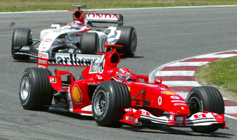 FILE PHOTO: Germany's Michael Schumacher leads Japan's Takuma Sato during the first lap of the Spanish Grand Prix in Barcelona.