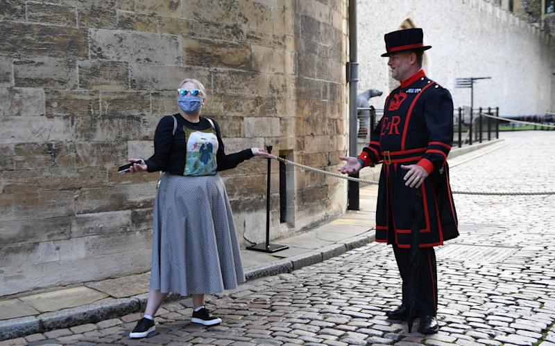 A visitor speaks with Yeoman Warder at the Tower of London following the Tower's reopening - ANDY RAIN/EPA-EFE/Shutterstock
