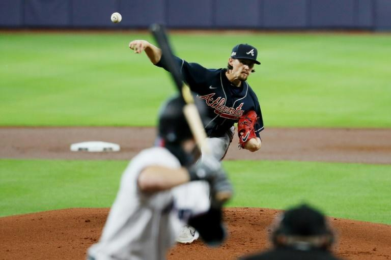Braves blank Miami, Astros bash A's to advance in MLB playoffs