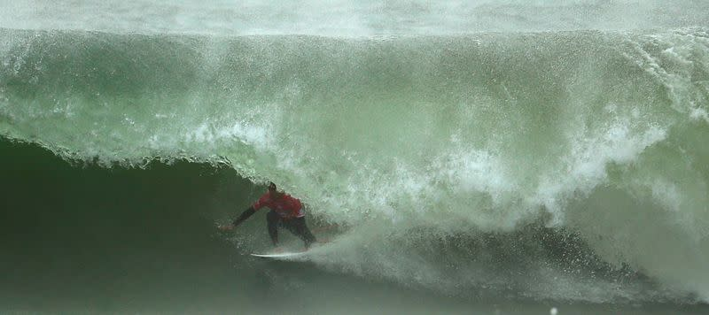 FILE PHOTO: Miguel Pupo of Brazil surfs during the World Surf League (WSL) championship at Supertubo beach in Peniche
