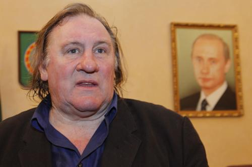 FILE - In this Sunday, Feb. 24, 2013 file photo, French actor Gerard Depardieu visits the museum of Akhmad Kadyrov, a warlord who switched sides and became a pro-Russian leader, in Chechnya's provincial capital Grozny, Russia. A lawyer for Gerard Depardieu said Friday, April 5, 2013 that the actor again couldn't make it in court to face drunken driving charges. Defense attorney Eric de Caumont says Depardieu was too busy filming a movie in the United States about another Frenchman known for run-ins with the law: former IMF chief Dominique Strauss-Kahn. (AP Photo/Musa Sadulayev, File)