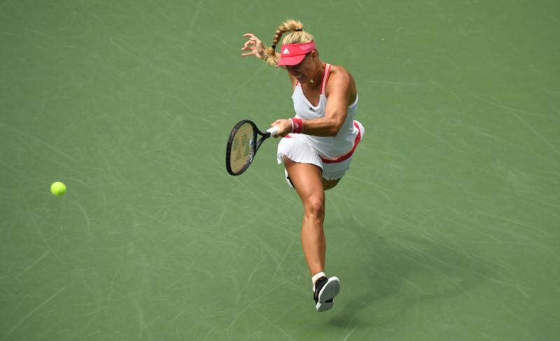 Former champion Kerber reaches second round in New York