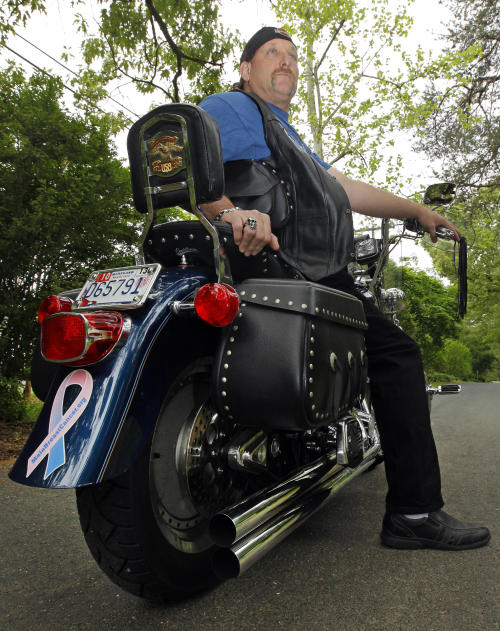 "In this May 3, 2012 photo, breast cancer survivor Robert Kaitz sits on his motorcycle, which displays a male breast cancer survivor ribbon, in Severna Park, Md. Kaitz thought a small growth under his left nipple was just a harmless cyst. By the time he had it checked out in 2006, almost two years later, the lump had started to hurt. The diagnosis of breast cancer was a shock. ""I had no idea in the world that men could even get breast cancer,"" Kaitz said. Now Kaitz does frequent self-exams and has mammograms every year. The American Cancer Society estimates 1 in 1,000 men will get breast cancer, versus 1 in 8 women. (AP Photo/Patrick Semansky)"