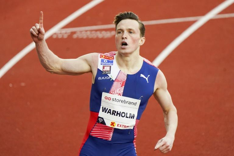 Double world 400m hurdles champion Karsten Warholm smashed the world record for the unorthodox 300m hurdles behind closed doors at a near-empty Bislett Stadion on Thursday
