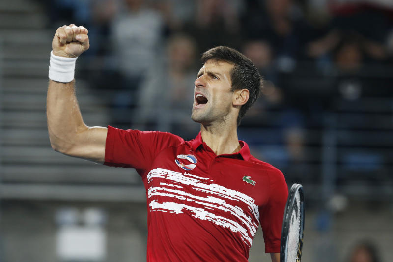Novak Djokovic of Serbia reacts to winning a point against Rafael Nadal of Spain during their ATP Cup tennis match in Sydney, Sunday, Jan. 12, 2020. (AP Photo/Steve Christo)
