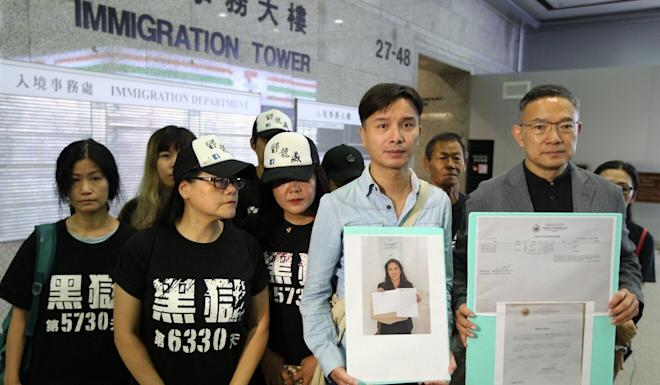 Tang Lung-wai's brother, Billy Tang Lung-piu (second from right), and lawmaker Paul Tse (right) at Immigration Tower in Wan Chai in August 2018. Photo: Roy Issa