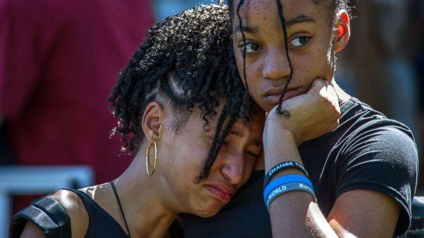 PHOTO: From left, Jalina Kohen and Brianna Hall join hundreds of community members at a prayer vigil at Parkridge Church, in Parkland, Fla., Feb. 15, 2018. (Giorgio Viera/EPA via Shutterstock)