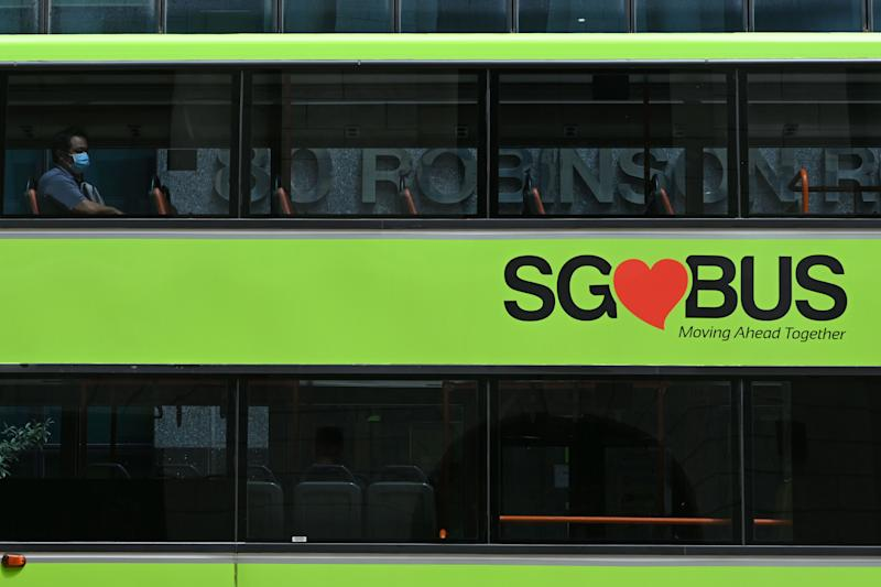 A lone commuter sits in the top deck of a public bus in Singapore on 7 April, 2020. (PHOTO: AFP via Getty Images)
