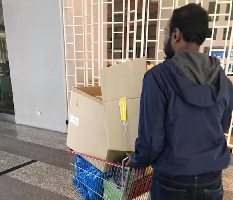Ganesh now also works for Aiman's company Natura, where he manages inventory and deliveries, whilst still juggling his daily deliveries. — Picture via Facebook/Aiman Manan.