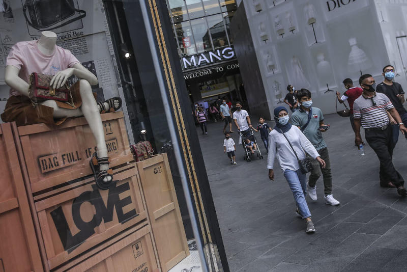 Pedestrians wearing face masks at a public area in Kuala Lumpur August 2, 2020. — Picture by Hari Anggara