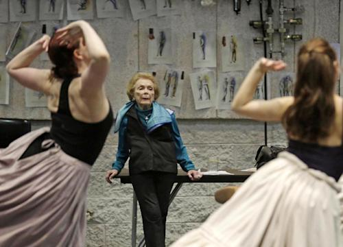 "In this April 26, 2013 photo, choreographer Gemze de Lappe oversees a rehearsal of Rodgers and Hammerstein's ""Oklahoma!"" at the Lyric Opera of Chicago. De Lappe first danced in ""Oklahoma!"" in 1943 as a member of the Broadway hit's first national touring company and now 70 years later at age 91 she's choreographing a production of the musical at the Lyric. (AP Photo/M. Spencer Green)"