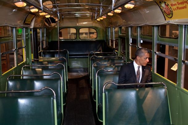 President Obama sits in the famous Rosa Parks bus at The Henry Ford