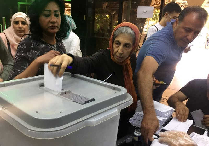 Syria goes to the polls as new sanctions hit war-ravaged economy