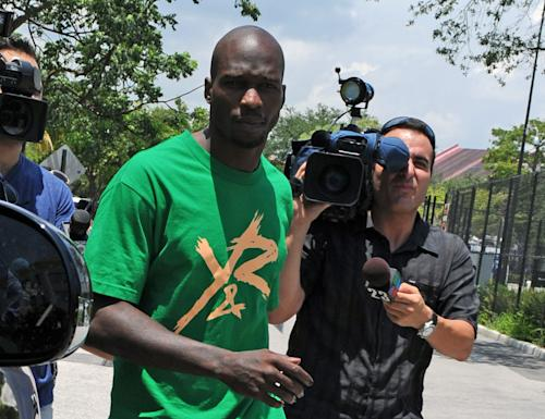 FILE - In this Aug. 12, 2012 file photo, Chad Johnson, center, leaves Broward County Jail in Fort Lauderdale, Fla. A contrite Johnson apologized Monday, June 17, 2013, for disrespecting a judge when the former NFL star slapped his attorney on the backside in court a week earlier, and his immediate release from jail was ordered. (Photo by Jeff Daly/Invision/AP, File)