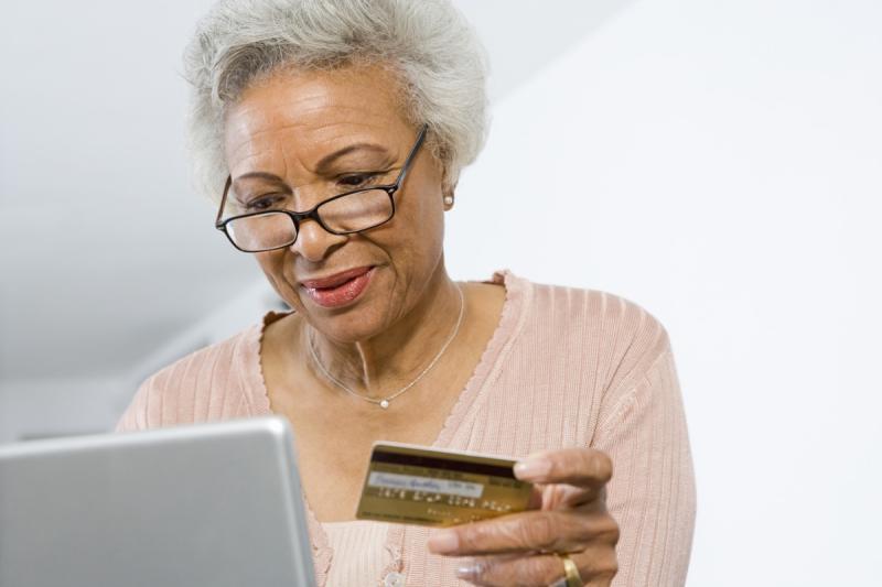 older woman shopping online, empty nest